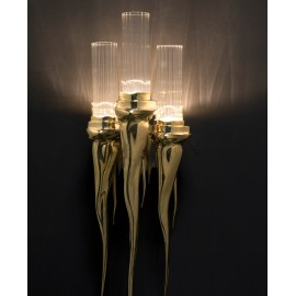Wax Wall Lamp Luxxu brass color in dining room