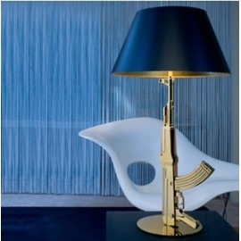 Gun table lamp Flos gold or black color in living room